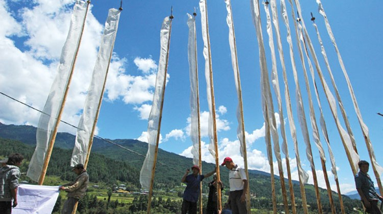 Prayer flags are constructed and raised in Bumthang.