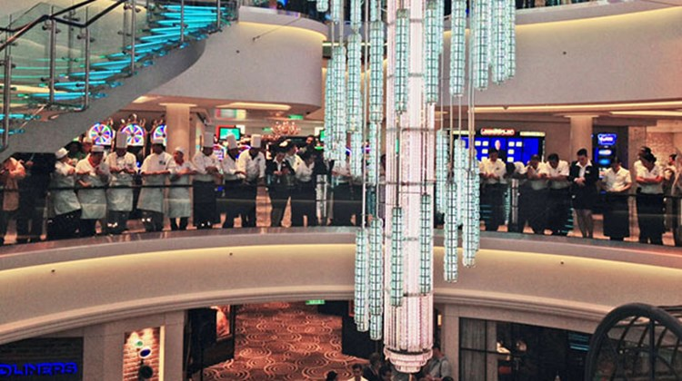 In a ceremony in New York May 8, Norwegian Cruise Line christened its newest ship, the 4,000-passenger Norwegian Breakaway. Pictured here, Norwegian Breakaway crew gathered in the ship's 678 Ocean Place before the christening. TW photo by Rebecca Tobin