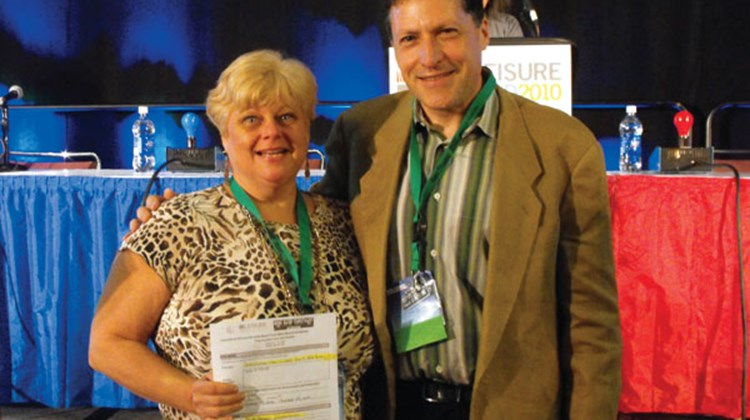 Among the prizewinners at the shows was Diane Monk of Deptford Travel Consultants, who won a stay at the Aria Resort and Casino in Las Vegas, courtesy of MGM Resorts. With her is Arnie Weissmann, Travel Weekly's editor in chief.
