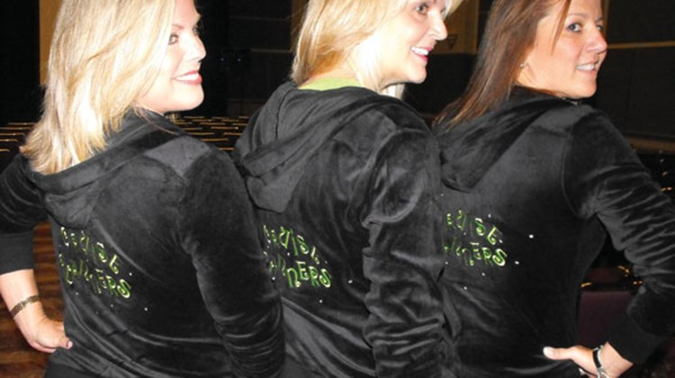 Terri Burke, Michelle Fee and Vicky Garcia show off their Cruise Planners hoodies.