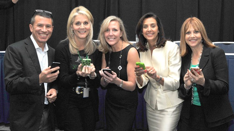 The judges at the Social Media Revolution session, from left: Andy Stuart of Norwegian Cruise Line, Michelle Fee of Cruise Planners, Ellen Bettridge of Silversea, Dondra Ritzenthaler of Celebrity and Vicki Freed of Royal Caribbean, with their mobile devices.