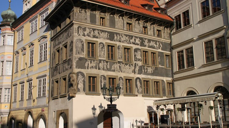 Striking sgraffito work adorns the Minute House, the Czech writer Franz Kafka's childhood home, seen on Prague's Old Town Square.