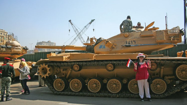 Travel Weekly's Michelle Baran was in Egypt for one week following the country's 18-day revolution, which prompted the evacuation of hundreds of U.S. citizens out of the country last month. Pictured here, a tourist poses in front of one of the tanks stationed at the entrance to the Egyptian Museum.