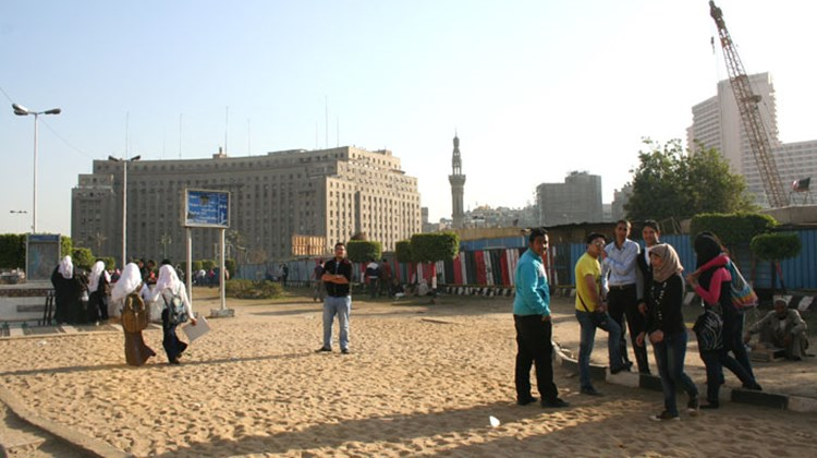 "Students mill about in the area that was a makeshift tent city in Tahrir Square during what became known as the ""Youth Revolution."""