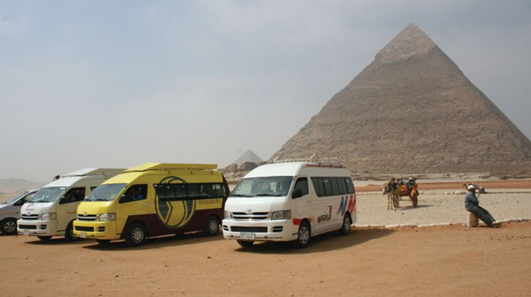 The parking lot at the pyramids, normally packed with motorcoaches, now hosts just a handful of tourist vans.