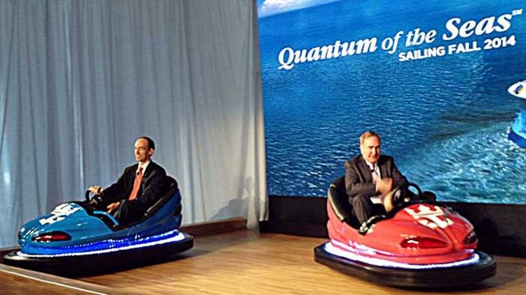 Royal Caribbean CEO Adam Goldstein and RCCL Chairman Richard Fain at the Quantum of the Seas reveal in bumper cars. Photo by Arnie Weissmann