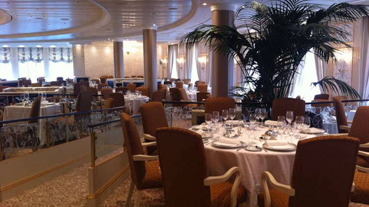 The Riviera's Grand Dining Room features golden hues, original artwork and live plants.