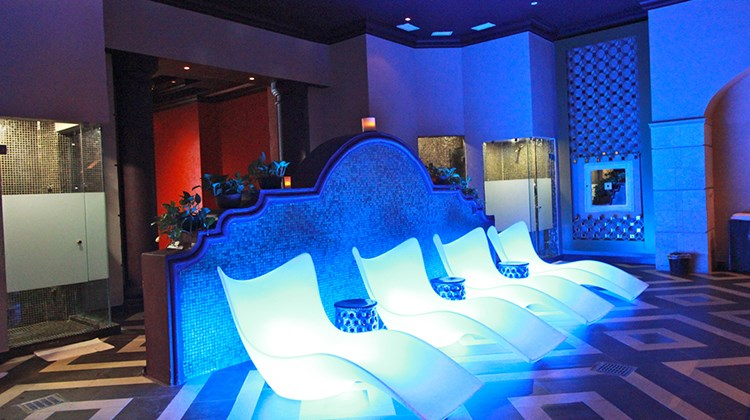 Colorful rooms and illuminated benches stand out at the hydrotherapy area.