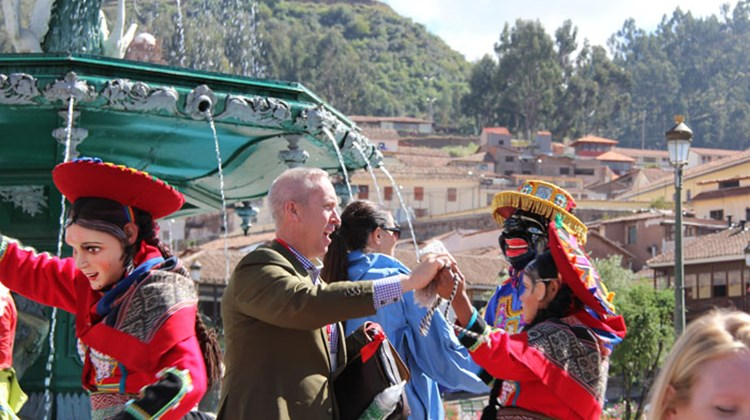 United States Tour Operators Association CEO Terry Dale dances with one of the entertainers in Cuzco.