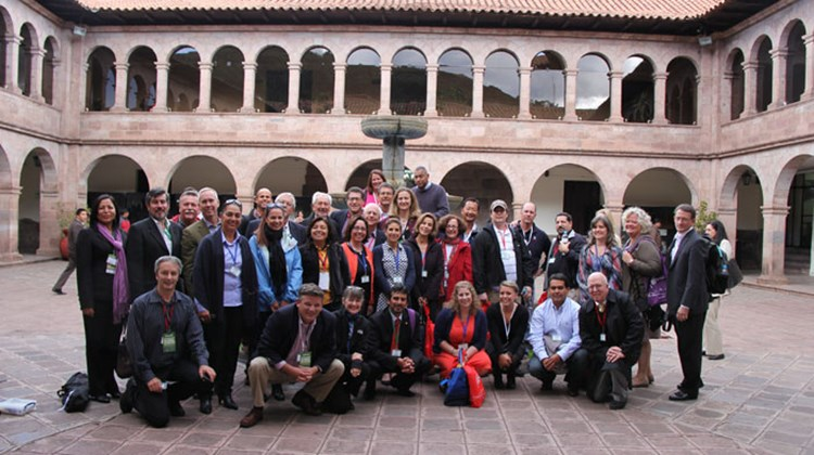Members of Tourism Cares and Turismo Cuida gather after their joint forum in Cuzco.