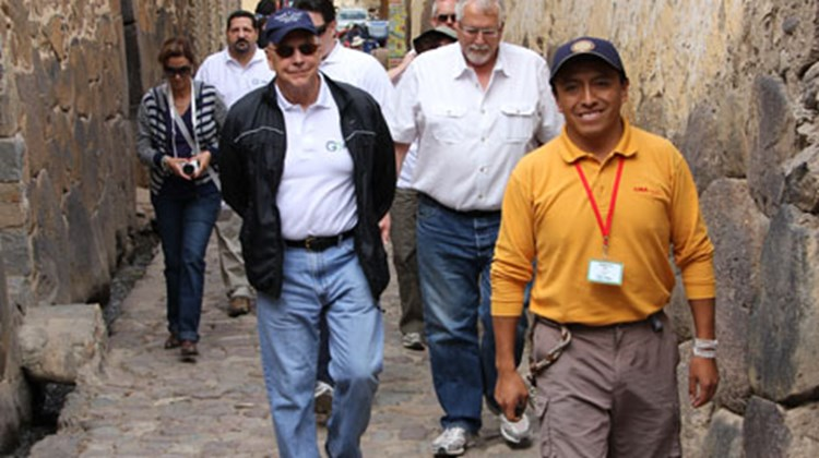 Lima Tours guide Ernesto Ore leads George Washington University professor Don Hawkins, center, Avanti Destinations president Harry Dalgaard, right, and other Tourism Cares members on a tour of Ollantaytambo.