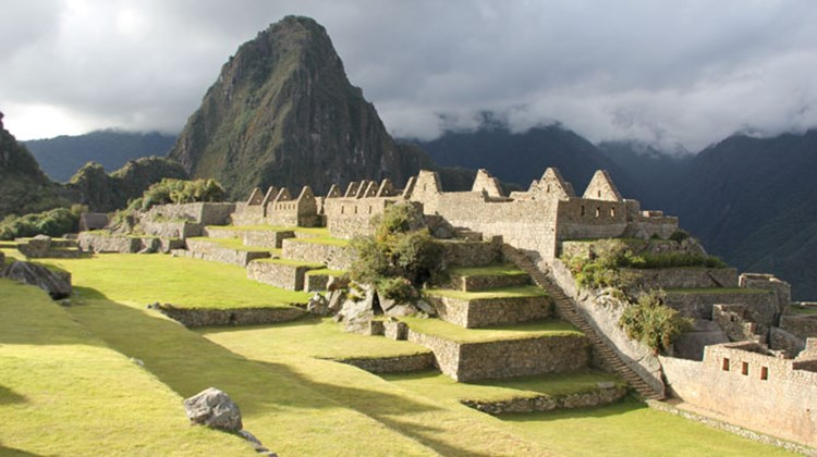 The first view of Machu Picchu was dramatic, lit by late afternoon sun and ringed by fog.