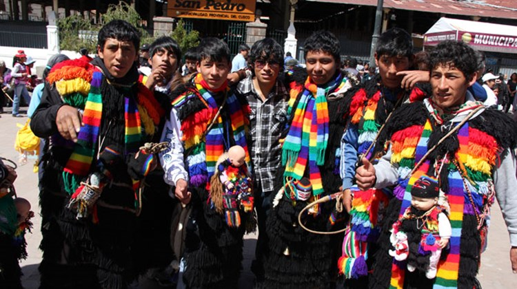 By coincidence, a group of colorfully dressed pilgrims were also gathering outside the Cuzco market to begin a trek into the mountains.
