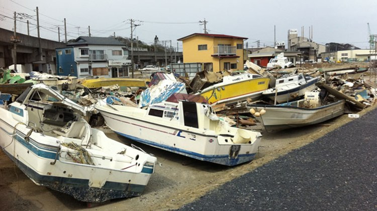 A salvage yard of boats damaged in the tsunami. Photo by Arnie Weissmann