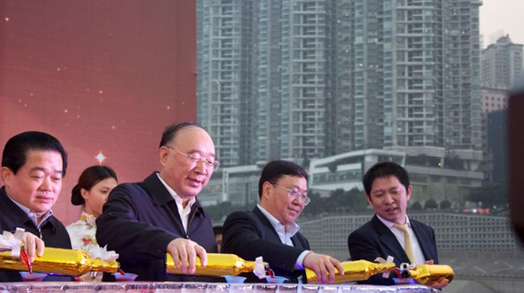 The mayor of Chongqing (second from left), and Century President Peng Jian Hu (far right), along with other dignitaries, preside over the ship launch festivities.