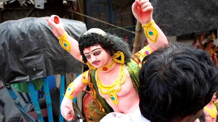 Preparing for the Durga Puja festival, during which images of the Goddess Durga are paraded around and thrown into the river.