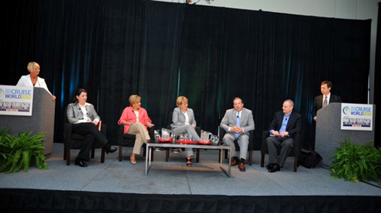 "At the ""Agent leaders discuss the future of the travel agent"" panel, seated from left: Nicole Mazza of Travelsavers, Priscilla Alexander of Protravel Interntional; Audrey Hendley of American Express, Steve Tracas of Vacation.com and Makis Xenatos of Liberty Travel. The panel was moderated by Joanie Ogg, far left, and Marc Mancini, far right."