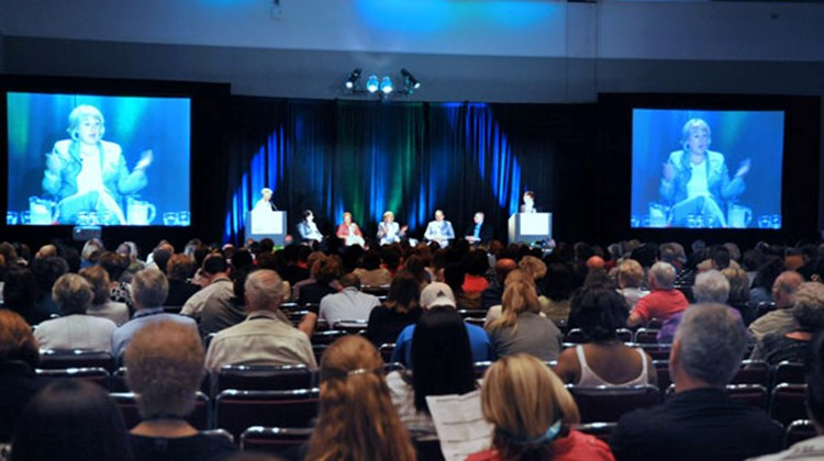 "Audience members listened to a discussion about ""the future of the travel agent."""