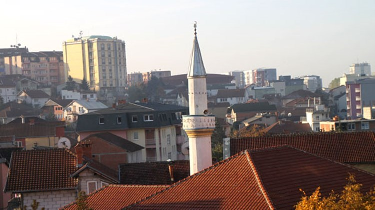 View of rooftops and a small minaret in the early morning, in Pristina, Kosovo's capital.