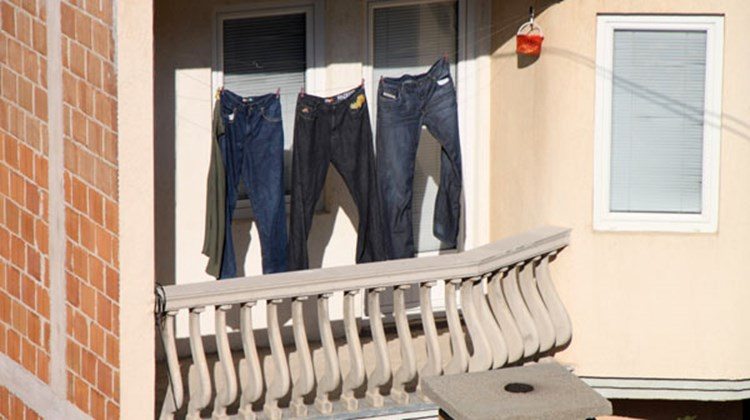 Laundry dries in the bright sun on an apartment balcony in the Kosovo capital, Pristina.