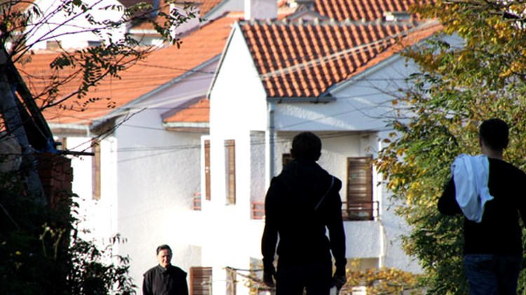 Residents walk along the roads in the hills above Kosovo's divided city of Mitrovica. These houses are on the Serbian side of town.