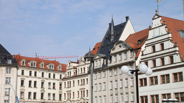 Historic buildings on the Market Square in Leipzig. The building at the far right is the 16th century Old Weigh House.