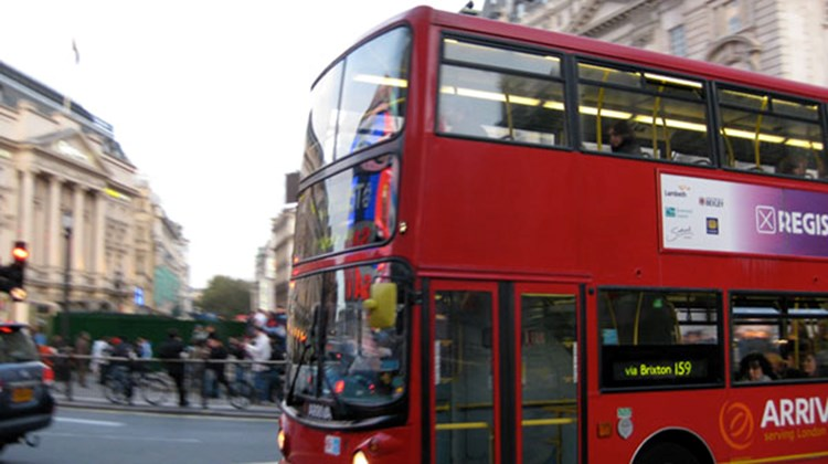 One of London's iconic double-decker buses traverses Piccadilly Circus.