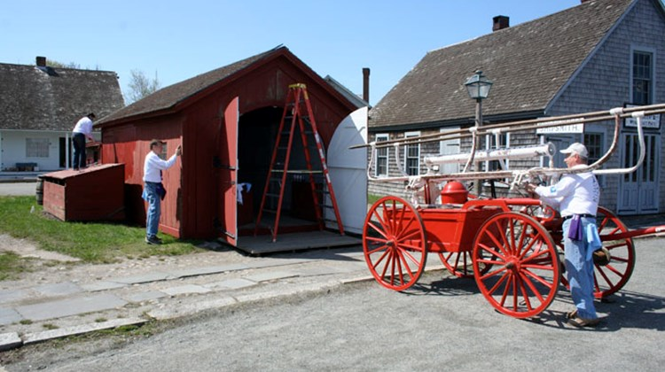 Volunteers paint and do much-needed maintenance work on the re-created 19th century village.
