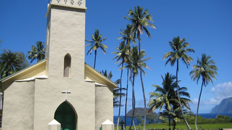 After his death in 1889, Saint Damien was buried next to St. Philomena's Catholic Church, seen here near Kalawao on the eastern coast of the Kalaupapa peninsula. Only his right hand remains interred at this site today, with the rest of his remains buried in Leuven, Belgium, near the village where he was born.