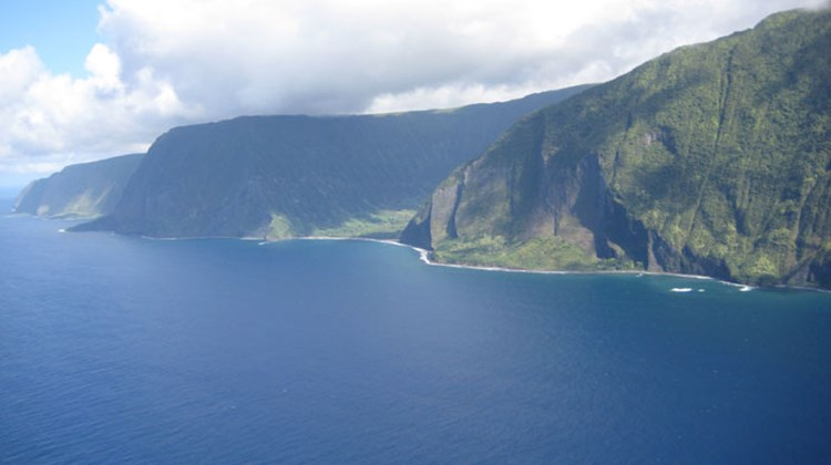 Molokai's North Shore sea cliffs are the tallest in the world with some towering more than 3,600 feet above the ocean.