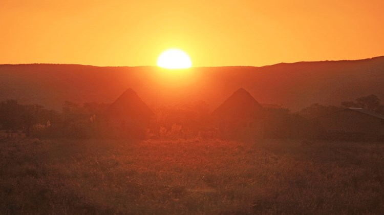 Huts silhouetted at sunset in Namib-Naukluft National Park.