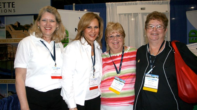 "From left, Kathy Humen, director, new business development, NEST, Oyster Bay, N.Y.; Rosemary Sarkis, senior director, business development, NEST, Oyster Bay, N.Y.; Jolaine Boasi, travel consultant for NEST-member TripGuy Travel, Kissimmee, Fla.; Carol Parlin, a ""fulfiller of wishes"" for TripGuy Travel."