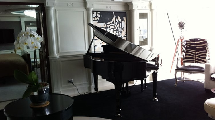 A baby grand piano in the Music Room of one of four Owner's Suites.