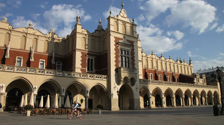 A cyclist crosses in front of the Cloth Hall, at the center of Krakow's Market Square. The building, now housing small shops, recalls the city's importance as a medieval trading center, when Krakow also was Poland's capital.