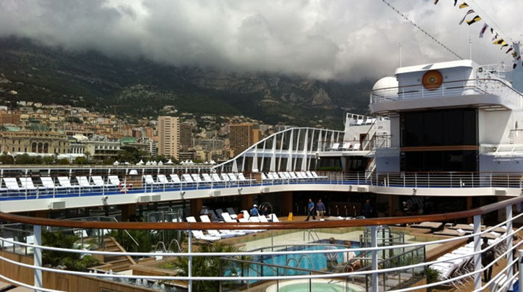 The Riviera's pool deck, with Monaco's Port Hercules in the background.