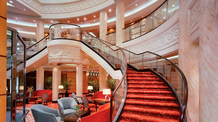 The sweeping staircase in the Queen Mary 2's lobby.