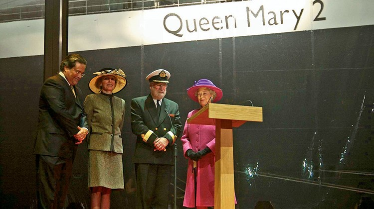 Carnival Corp. Chairman Micky Arison, then-Cunard President Pamela Conover, Commodore Ronald Warwick, the QM's captain, and Queen Elizabeth II at the ship's naming ceremony.