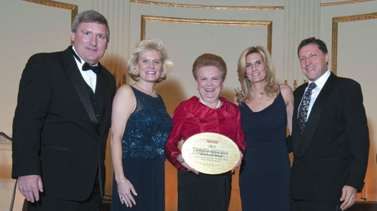 Wilson is flanked by Travel Weekly Publisher Bob Sullivan, Valerie Wilson Travel co-presidents Jennifer Wilson-Buttigieg and Kimberly Wilson Wetty, and Editor in Chief Arnie Weissmann.