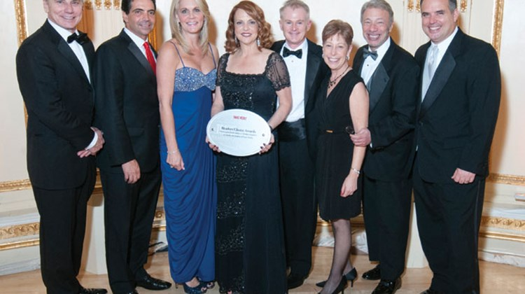 From left, Dwain Wall, SVP and GM of CruiseOne & Cruises Inc.; Joe Jiffo, Ensemble's VP for business development; Cruise Planners CEO Michelle Fee; Vicki Freed, SVP of sales, trade support and service for Royal Caribbean International; David Crooks, World Travel Holdings SVP of product and operations; Helen and Tom Coiro of Direct Line Cruises, Hauppauge, N.Y.; and Steve McGillivray, chief marketing officer of the Travel Leaders Group.