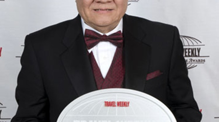 Larry Kwan, president of Pacific Delight Tours, accepted the award for top tour operator in the Asia-Pacific region.