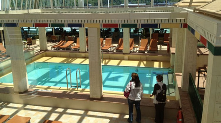 Agents on the Rhapsody of the Seas ship inspection tour the ship's enclosed pool area. Photo by Johanna Jainchill