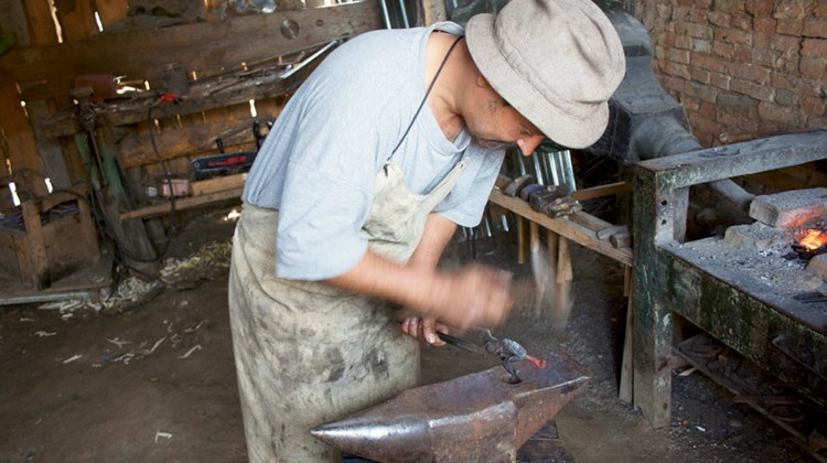 A blacksmith in the Transylvanian town of Viscri  demonstrates his ancient trade. TW photo by Michelle Baran