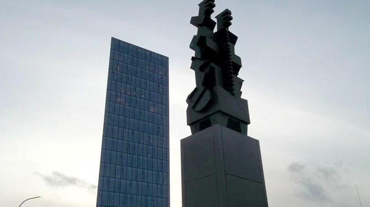 A sculpture by commemorating the founding of Reykjavik and an office tower built during Iceland's recent boom years.