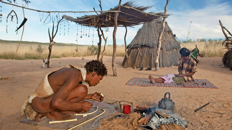 Bushmen are showcasing how to make weapons at the Bushman cultural village, near Xaus Lodge, Kgalagadi Transfrontier Park in Botswana.