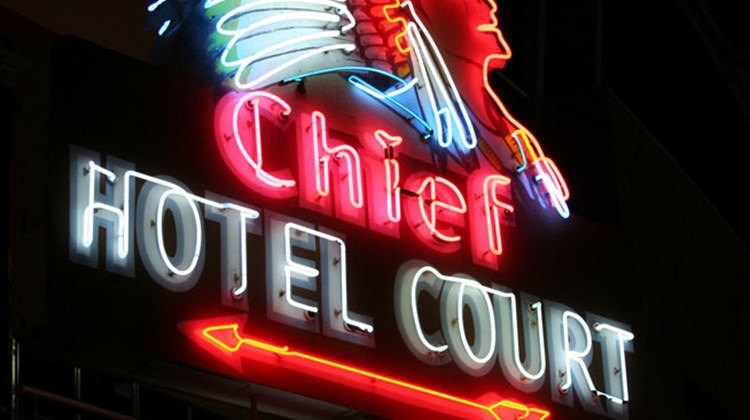 The Chief Hotel Court opened in 1939 near Las Vegas' downtown district at 1201 E. Fremont Street. The neon sign that remains from the property was created circa 1940, making it one of the oldest neon signs in Las Vegas today. It has been completely restored and is now installed as  public art throughout the downtown Las Vegas area.