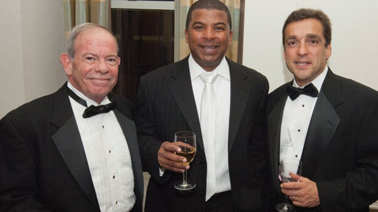 Cheers: Warren Cohen, left, and Dwight Johnson, center, of Sandals Resorts International, share a Readers Choice Awards toast with George Lanzaro of Rocky Mountaineer.