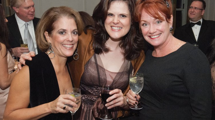 Christine Stevens, left, and Susan Prinzing, center, both of Holland America Line and Seabourn Cruise Line, get the party started with Katie Gerhard of Carnival Cruise Lines.