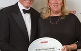 Travel Weekly's Jack Grant with Alice McQuade of IHG, which won Hotel Chain honors for Asia and Europe.
