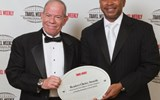 Sandals Resorts International's Warren Cohen, left, and Dwight Johnson accepted two hotel category awards.