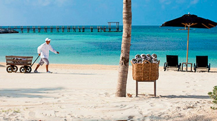 Beach butlers roam the beach at Nizuc Resort & Spa, bringing towels, beverages, menu items and sunscreen.